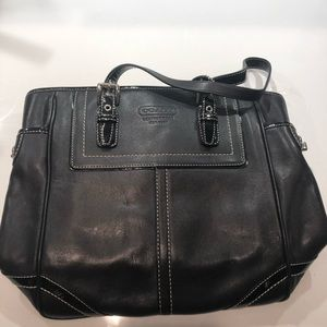 Black Coach tote with patent leather straps